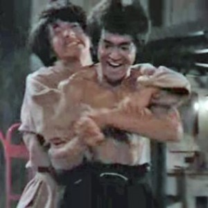 Pictured: Jackie Chan being brutally killed by Bruce Lee in Enter the Dragon.