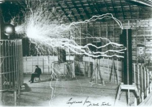 Actual picture of Nikola Tesla reading via the light of his LIGHTNING MACHINE!